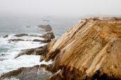 Waves on a foggy calif coastline — Stock Photo
