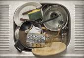 Dirty dishes in the sink — Stock Photo