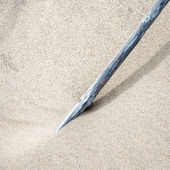 Pole standing in the sand — Stock Photo