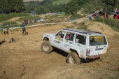 White car in the difficult terrain — Foto Stock