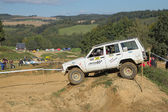 White off road car is hitting a steep hill — Stock Photo