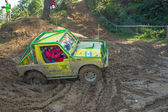 Yellow off road car in the mud terrain — Stock Photo