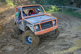 Small off road in the mud terrain — Stock Photo
