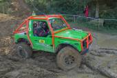 Small  green off road in the mud  — Stock Photo