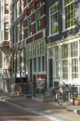 Sunny street in Amsterdam — Stok fotoğraf
