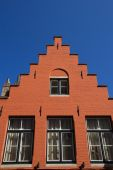 Orange historic house in Bruges — Stock Photo
