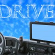 Dashboard of the truck with Drive word in the blue sky — Stock Photo #72072885