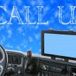 Dashboard of the truck with CALL US words in the blue sky — Stock Photo #72072895