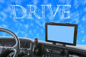 Dashboard of the truck with Drive word in the blue sky — Stock Photo