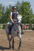 Young horsewoman on the white horse — Stock Photo