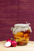 Jar of pickled of cheese with radish. Vertically. — Stock Photo