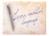 Old paper grunge background - Learn another language — Stock Photo