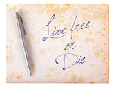 Old paper grunge background - Live free or die — Photo