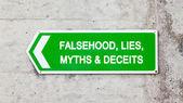 Green sign - Falsehood lies myths deceits — Stock Photo