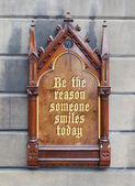 Decorative wooden sign - Be the reason someone smiles today — Photo