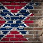 Dark brick wall with plaster - Confederate flag — Stock Photo #53152607