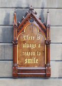 Decorative wooden sign - There is always a reason to smile — Photo