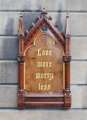 Decorative wooden sign - Love more worry less  — Stock fotografie