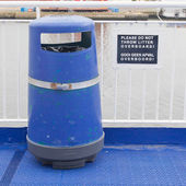 Blue bin on deck of cruise liner — Stock Photo