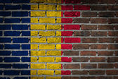 Brick wall texture with flag — Stock Photo