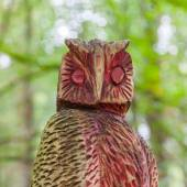 Old wooden carved owl — Stock Photo