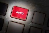 Red button on a dirty old panel — Stock Photo