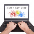 Man working on laptop, happy new year — Stock Photo #61177801