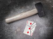 Hammer with a broken card, three of diamonds — Stock Photo