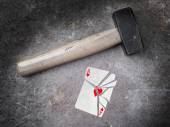 Hammer with a broken card, ace of hearts — Stock Photo