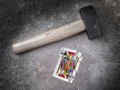 Hammer with a broken card, jack of clubs — Stock Photo