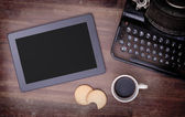 Tablet touch computer gadget on wooden table — Stock Photo