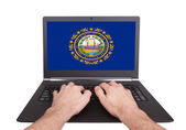 Hands working on laptop, New Hampshire — Stock Photo