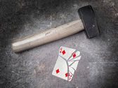 Hammer with a broken card, four of diamonds — Stock Photo