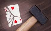 Hammer with a broken card, two of hearts — Stockfoto