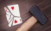 Hammer with a broken card, two of hearts — Zdjęcie stockowe