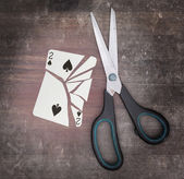 Concept of addiction, card with scissors — Stockfoto