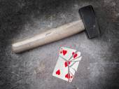 Hammer with a broken card, five of hearts — Foto de Stock