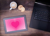Heart shape backgound on tablet — Stock Photo