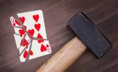 Hammer with a broken card, nine of hearts — Stock Photo