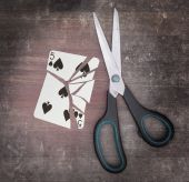 Concept of addiction, card with scissors — Stock Photo