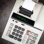 Old calculator - payroll — Stock Photo #68864047