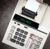 Old calculator - salary — Stock Photo