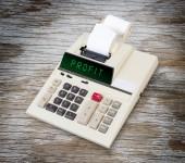 Old calculator - profit — Zdjęcie stockowe