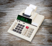 Old calculator showing a percentage - 60 percent — Stock Photo