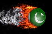 Bandera con un rastro de fuego y humo - Pakistán — Foto de Stock
