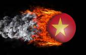 Flag with a trail of fire and smoke - Vietnam — Stock Photo