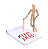 Деревянный манекен, писать записки - с Рождеством — Стоковое фото