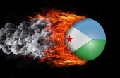 Flag with a trail of fire and smoke - Djibouti — Stock Photo