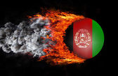 Flag with a trail of fire and smoke - Afghanistan — Foto Stock