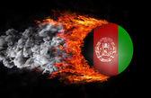 Bandeira com um rastro de fogo e fumaça - Afeganistão — Fotografia Stock
